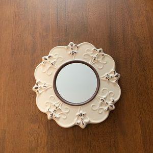 Worn ceramic wall mirror